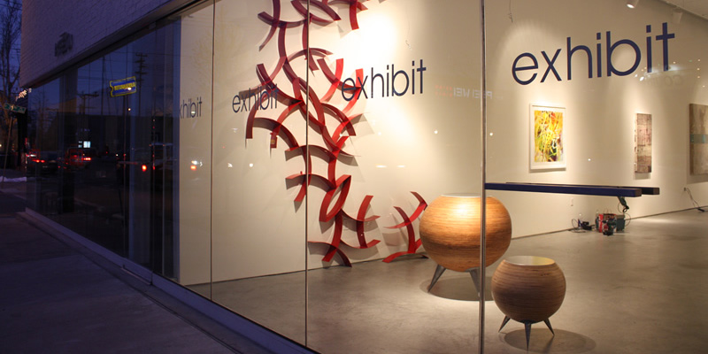 Curves 8 (red wall hanging sculpture) and Spheres (round tables), 2010